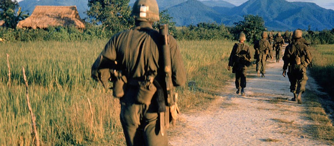 Vietnam War 1957 - 1975 American soldiers on a patrol South Vietnam 1965 equipment equipments road roads dirt path dirt track